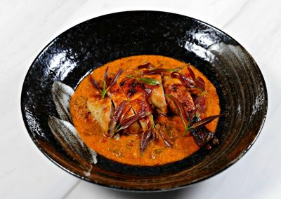 Oven-roasted-chemical-free-chicken-lacquered-with-pure-palm-sugar-and-wild-honey.-Served-with-Kanchanaburi-red-curry-sour-lea