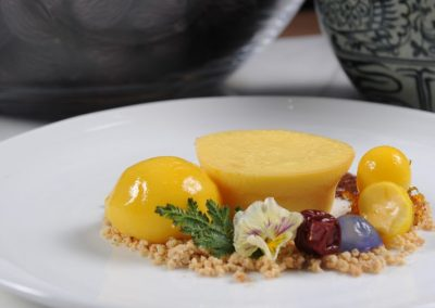 Monthong Durian Cheesecake with Mango Sorbet, Pistachio Crumble and Kumquat Marmalade