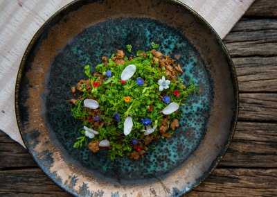 Northern larb salad of pheasant with mouth numbing mak-wean pepper, cloves, hog plum leaves and herb paste