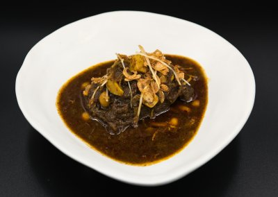 Northern Shan version of Hang Lay curry with slow cooked Australian beef cheek pickled garlic, and dry spices