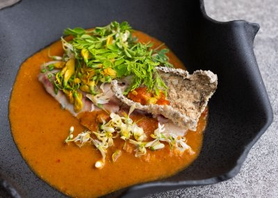 Salt baked seabass, Laos-Vieng style sour orange curry, with roasted mung beans and drum stick flowers